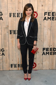 Sophia Bush oozed sporty style in a white-trimmed black pantsuit at the Feed USA + Target launch.