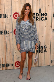 Kelly Bensimon let her dress stand out by pairing it with simple black thong sandals at the Feed USA + Target launch.