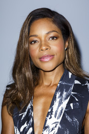 Naomi Harris sweetened up her look with glossy pink lipstick.
