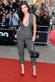 Daisy Lowe showed major cleavage in a low-cut gray Barbara Casasola jumpsuit at the GQ Men of the Year Awards.