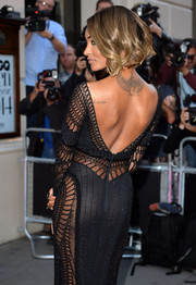 Wearing a backless gown at the GQ Men of the Year Awards, Jourdan Dunn showed off her tattoo of the Egyptian goddess Isis.