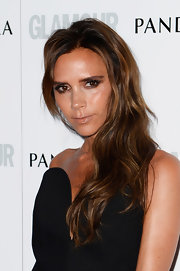Victoria Beckham parted her waves to one side for a touch of glam!