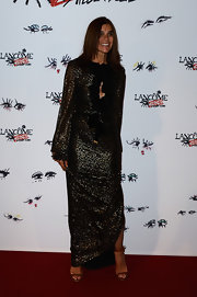 Carine Roitfeld showed off her sleek style at the Lancome Show by Albert Elbaz party where she wore this full-length, long-sleeve sparkly dress.