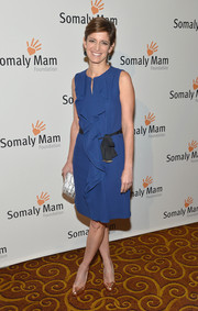 Cindi Leive attended the Life is Love Gala looking classic and feminine in a ruffled blue cocktail dress.