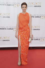 Bitsie Tulloch chose a tangerine column-dress with a splatter-print skirt for her red carpet look.