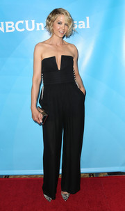 Jenna Elfman added some shine to her outfit via a mirrored clutch.