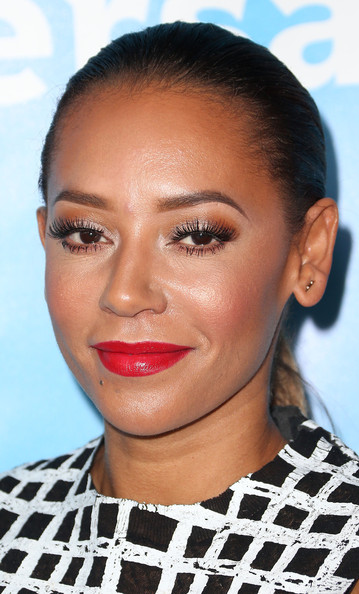 Melanie Brown went for a standout beauty look with bold red lips and dramatic eyes.