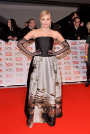 Pixie Lott chose an Alberta Ferretti strapless gown, featuring a fitted black bodice and an abstract-patterned skirt, for the National Television Awards.