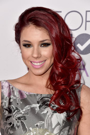 Jillian Rose Reed fixed her striking red locks into a curly side sweep for the People's Choice Awards.
