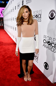 Naya Rivera chose simple nude sandals by Stuart Weitzman to complete her ensemble.