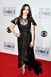 Kat Dennings served up plenty of ladylike allure at the People's Choice Awards in a black lace fishtail dress.
