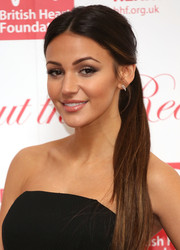 Michelle Keegan pulled her long locks back into a center-parted ponytail for the Roll Out the Red Ball.