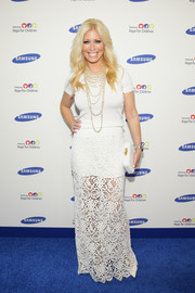 Jill Martin paired her top with a long white crochet skirt for a dressier finish.