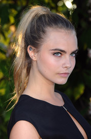 Cara Delevingne pulled her hair back into an edgy high ponytail for the Serpentine Gallery Summer Party.