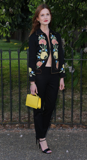 Bonnie Wright bared her belly button in a floral cropped jacket with no shirt underneath during the Serpentine Gallery Summer Party.
