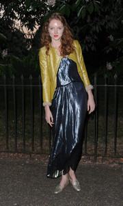 Lily Cole finished off her shimmery ensemble with a pair of silver smoking slippers.