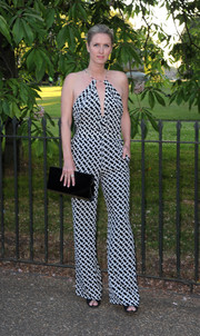 Nicky Hilton teamed her groovy jumpsuit with a simple black hard-case clutch.