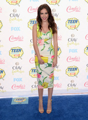 Ryan Newman let her cute dress shine by accessorizing with simple nude ankle-cuff sandals.