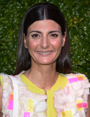 Giovanna Battaglia topped off her look with a simple center-parted 'do when she attended the Tribeca Film Festival Artists Dinner.