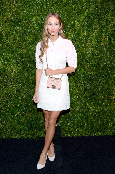 Harley Viera-Newton accessorized with a very ladylike pink chain-strap bag by Chanel.