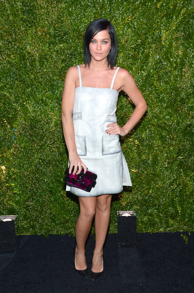 Leigh Lezark was on trend with her purple and black Chanel Lego clutch.