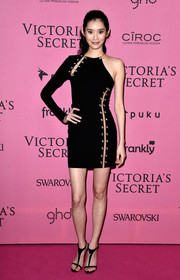 Ming Xi went for ultra-modern sexiness in an asymmetrical, safety pin-accented cutout dress by Anthony Vaccarello x Versus Versace at the Victoria's Secret after-party.