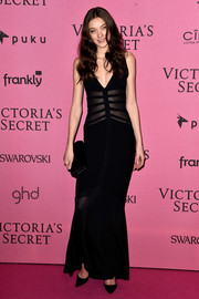 Yumi Lambert looked sultry in a deep-V black gown with a sheer, striped bodice at the Victoria's Secret fashion show after-party.