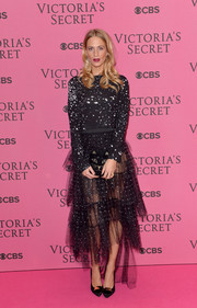 Poppy Delevingne kept it trendy in a spotted crop-top during the Victoria's Secret fashion show.