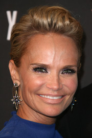 Kristin Chenoweth showed off her edgy side with this fauxhawk at the 2014 Weinstein Golden Globes after-party.