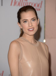 Allison Williams was minimalist-chic at the Women in Entertainment Breakfast with this simple ponytail and nude dress combo.