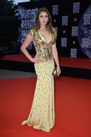 Nina Dobrev went for total glitter in an embellished gold gown by Jenny Packham during the World Music Awards.