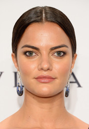 Barbara Fialho went for classic elegance with this center-parted chignon during the amfAR New York Gala.