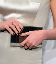 Crystal Renn completed her jewels with a pair of diamond bar rings.