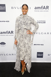 Kelly Rowland chose a conservative yet stylish black-and-white print dress for the amfAR New York Gala.