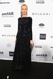 Daria Strokous cut a regal figure in a long-sleeve, embellished black gown during the amfAR New York Gala.