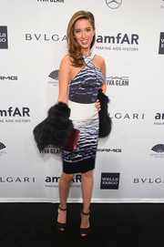 Melissa Bolona was modern and sexy at the amfAR New York Gala in a black-and-white print dress, made more glam with a fur stole.