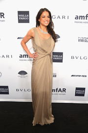Michelle Rodriguez unleashed her inner goddess at the amfAR New York Gala in a draped nude Alberta Ferretti gown with twisted detailing.
