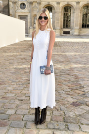 Lala Rudge looked breezy in a sleeveless white Dior dress with button-up detailing during the brand's fashion show.