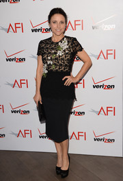 Julia Louis-Dreyfus paired an appliqued black lace top by Oscar de la Renta with a pencil skirt for her AFI Awards look.