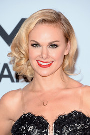 Laura Bell Bundy was a charmer with this side-swept curly updo at the CMA Awards.