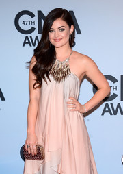 Lucy Hale went for total glamour at the CMA Awards, pairing a gold clutch with a flowy gown.
