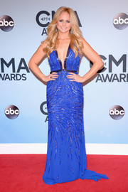 Miranda Lambert looked super sexy at the CMA Awards in a beaded blue Roberto Cavalli gown with a plunging neckline.