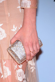 Kacey added some bling with this cute hard-cased clutch.