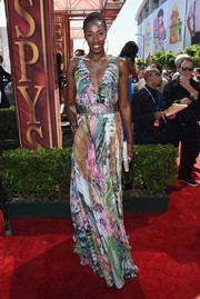 Lisa Leslie was summer-glam in a low-cut, colorful floral gown by DeanZign during the ESPYs.