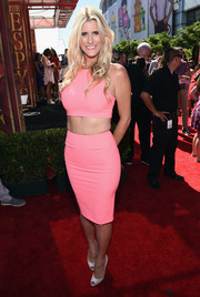 Beccy Gordon kept the sexy vibe going with a super-tight pink skirt.