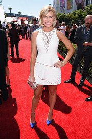 Courtney Force went for an ultra-girly vibe at the ESPYs in a little white lace dress with a sheer yoke and peplum detailing.