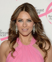 For total glamour, Elizabeth Hurley accessorized with a pair of diamond chandelier earrings by Chopard.