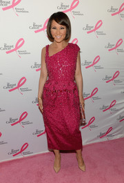 Alina Cho chose a beaded wine-colored dress with an asymmetrical neckline for the Hot Pink Party.