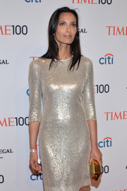 Padma Lakshmi paired a metallic gold clutch with a silver sequin dress for total shimmer at the Time 100 Gala.