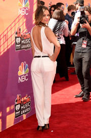 Pia Toscano donned a white-hot backless jumpsuit for the iHeartRadio Music Awards.